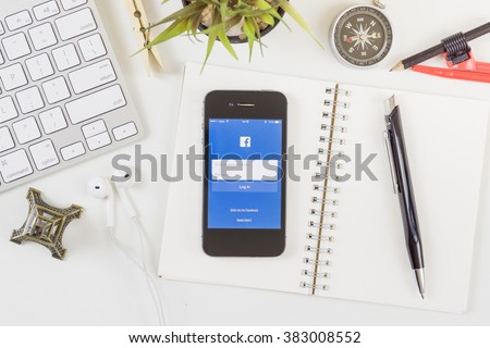 BANGKOK, THAILAND - FEB 20,2016: The Facebook iOS application is launching on iPhone. The login screen is showing. Facebook is the social network application that connects people together online. - stock photo