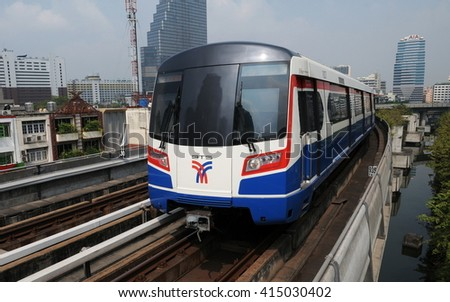 Bangkok, Thailand - February 16, 2011: A BTS Skytrain runs on elevated railway tracks through the city centre. Each train of the Thai capital's mass transport rail network can carry 1,000 passengers. - stock photo