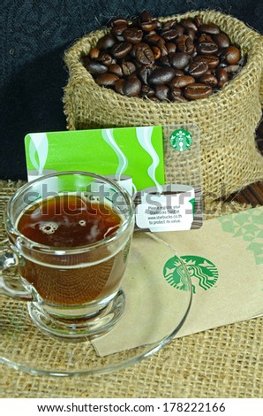 BANGKOK, THAILAND - FEBRUARY 23, 2014: A new Starbucks card available for member in Thailand. Starbucks is the largest coffee franchises in the world, currently. - stock photo