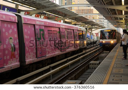BANGKOK, THAILAND - FEBRUARY 05, 2015: BTS train arriving at station. BTS or the Skytrain is an elevated rapid transit system in Bangkok, Thailand