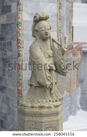 BANGKOK, THAILAND - FEBRUARY 19, 2015: Statue of chinese woman at Wat Phra Kaew in Bangkok, Thailand. - stock photo