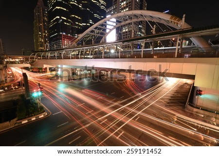 Bangkok,Thailand -  February 25,2015 :The traffic at night on Sathon road, the business centre in Bangkok,Thailand.