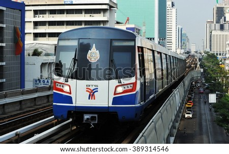 BANGKOK, THAILAND - JAN 25, 2013: A BTS Skytrain runs on elevated railway tracks through the city centre. Each train of the Thai capital's mass transport rail network can carry over 1,000 passengers. - stock photo