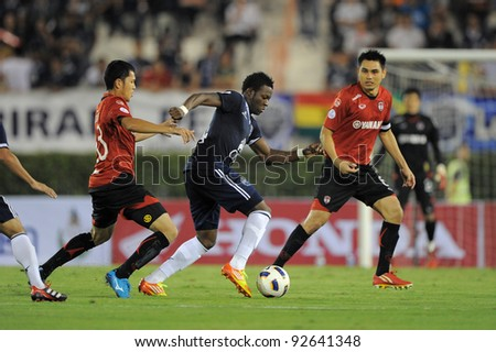 BANGKOK, THAILAND - JAN 11: Franck Ohandza Zoa of the Buriram PEA (C) in action during the Thaicom FA Cup Final match  between MuangThong United at National Stadium on January 11, 2012 in Bangkok Thailand. - stock photo