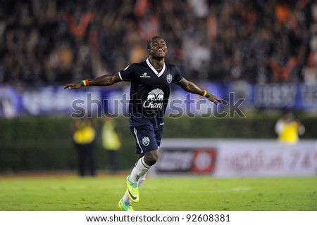 BANGKOK, THAILAND - JAN 11: Frank Opoku Acheampong of the Buriram PEA celebrates scoring during the Thaicom FA Cup Final match  between MTUTD.at National Stadium of Thailand on Jan11, 2012 in BKK Thailand. - stock photo