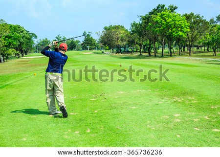 Bangkok,Thailand-Jan 20,Man golf player with driver teeing-off from tee-box to shoot  view from beside on Jan 20,2016. - stock photo