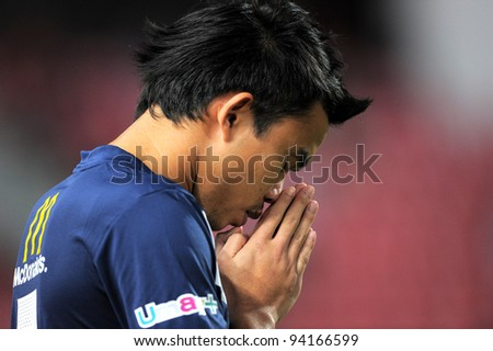 "BANGKOK THAILAND-JAN18:Sumanya Purisri of Thailand traditional ""wai""  before games during the 41st King's cup  between Thailand and Norway at Rajamangala stadium on Jan18,2012 in Bangkok,Thailand."