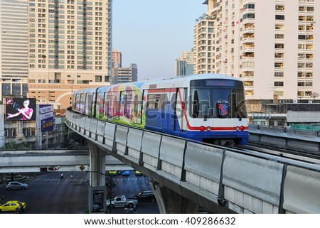 Bangkok, Thailand - January 2, 2011: A BTS Skytrain runs on elevated rails in the city centre. The Thai capital's mass public transport rail network carries 600,000 passengers daily.  - stock photo