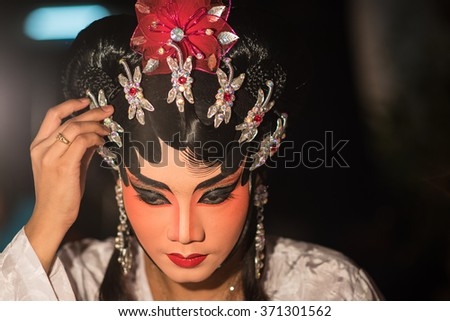 BANGKOK, THAILAND - JANUARY 14, 2016: A Chinese actress is doing make up before the show of traditional Chinese opera. - stock photo