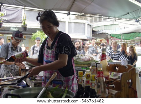 BANGKOK,THAILAND,JANUARY 2,2017 : A woman is cooking Tomyumkung in the sidewalk shop at Banglumpoo, Bangkok,Thailand