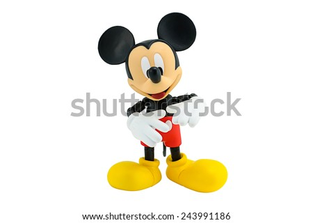 Bangkok, Thailand - January 6, 2015: Mickey Mouse action figure the official mascot of The Walt Disney Company. Mickey Mouse is a funny animal cartoon character was created by Walt Disney studio. - stock photo