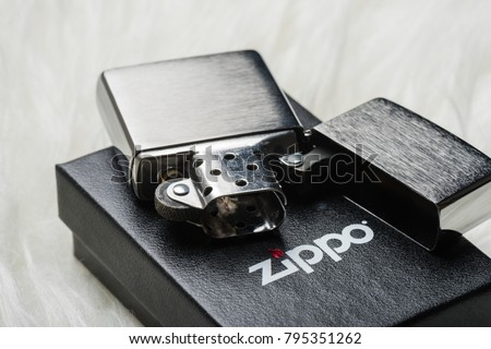 BANGKOK, THAILAND - JANUARY 16, 2018: Not used Zippo brushed chrome lighter with windproof. Zippo lighters have gained popularity as windproof lighters.