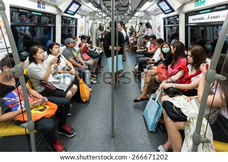 BANGKOK, THAILAND, JANUARY 12, 2015: Passengers inside in the Bangkok Mass Transit System (BTS) skytrain in Thailand - stock photo