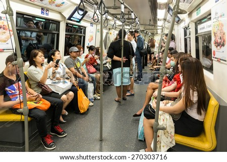 BANGKOK, THAILAND, JANUARY 12, 2015: Passengers inside in the Bangkok Mass Transit System (BTS) public train in Thailand - stock photo