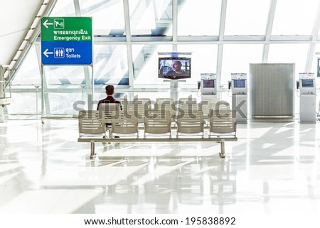 BANGKOK,THAILAND - JANUARY 5, 2010: people wait at departure terminal of Suvarnabhumi International Airport in Bangkok, Thailand. The airport is handling about 45 million passengers annually. - stock photo