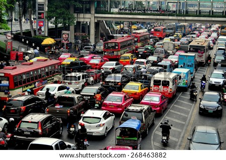 Bangkok, Thailand - January 22, 2013:  The city's legendary traffic stands bumper-to-bumper during the evening rush hour on Thanon Ratchaprasong - stock photo