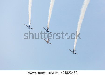Bangkok Thailand 10 January 2017:The PC-9 Mustang from Royal thai air force  was showing the flying in group with smoke to Children in Don muang international airport