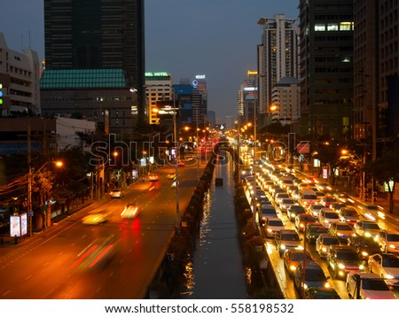 Bangkok, Thailand - January 15: Traffic at Sathorn Road (CBD) which surrounded by many big buildings on Sunday evening on January 15, 2017