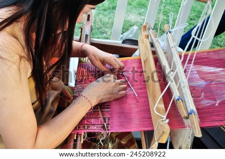 Bangkok, Thailand - January 16, 2015 Unidentified Thai woman in traditional custom she weaving the folk crafts of traditional at Lumpini Park, when the day of Thailand's travel festival.  - stock photo