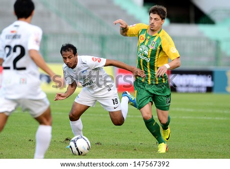 BANGKOK,THAILAND-JU LY 20: Bjorn Lindemann (R) of Army United in action during the Thai Premier League between Army United and Chonburi FC at Army stadium on July 20, 2013 in Bangkok,Thailand.