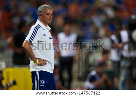 BANGKOK,THAILAND-JU LY17:Manager Jose Mourinho of Chelsea look on during the international friendly match Chelsea FC and Singha Thailand All-Star at the Rajamangala Stadium on July17,2013 in Thailand. - stock photo