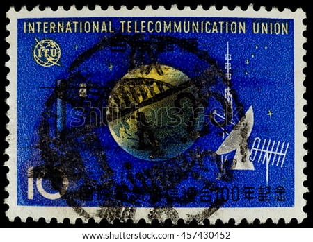 BANGKOK, THAILAND - JULY 18, 2016: A postage stamp printed in Japan shows world globe with telecommunication type, circa 1965. - stock photo