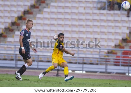 BANGKOK,THAILAND:JULY 2015:Addison(yellow)and Sukimoto(blue)in action football Thai Premier League between Osotspa M150 and Chiang Rai United at Rajamangala National Stadium on July19,2015;Thailand.  - stock photo