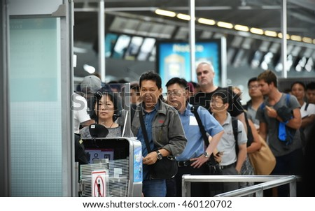 Bangkok, Thailand - July 12, 2016: Air travellers queue at immigration control at Suvarnabhumi Airport. The SE Asia aviation hub handles 45 million passengers annually. - stock photo