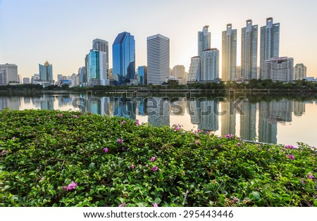 Bangkok, Thailand - July 11:Benjakitti park, Bangkok downtown city in the Morning with skyline reflection on  July 11, 2015.