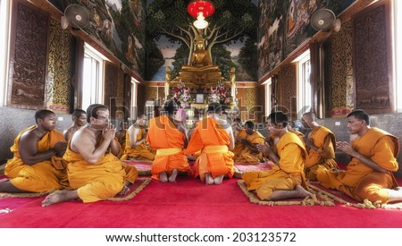 BANGKOK THAILAND - JULY 6: Buddha image and monks in Temple, on July 6, 2014 in Bangkok,Thailand.