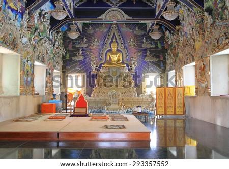 BANGKOK - THAILAND - July 4 : Buddha statue in beautiful Thai style church under decoration  of Wat Pariwat on July 4, 2015 in Bangkok, Thailand. - stock photo