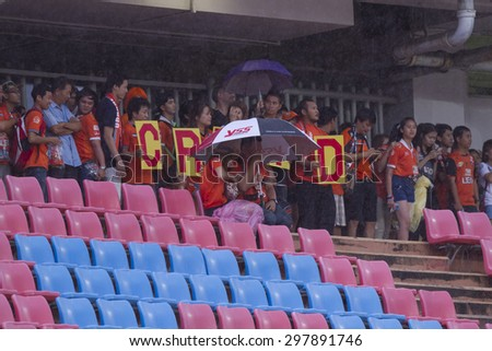 BANGKOK,THAILAND:JULY 2015:Cheering of Chiang Rai in the rain between Osotspa M150 vs Chiang Rai United at Rajamangala National Stadium;inThai Premier League on19July2015,Bangkok Thailand.  - stock photo