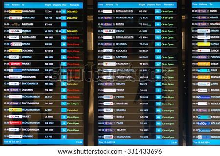 BANGKOK, THAILAND - 15 JULY 2014: Digital schedule board announcing flight departures at Suvarnabhumi Airport in Bangkok, Thailand. - stock photo