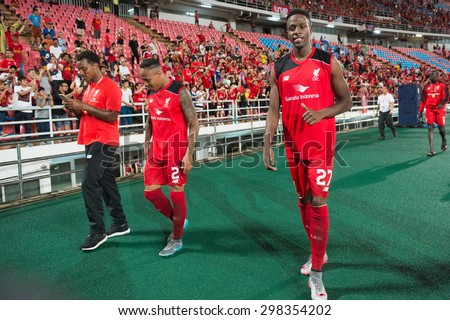 BANGKOK THAILAND JULY14:Divock Origi (R)of Liverpool acknowledges the fans during the international friendly match  Thai All Stars and Liverpool FC at Rajamangala Stadium on July14,2015 in,Thailand. - stock photo