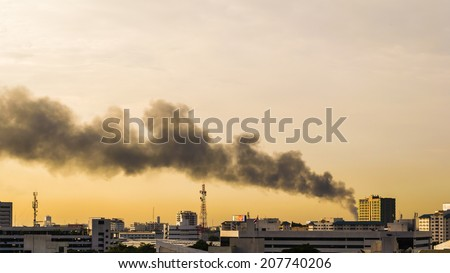 Bangkok, Thailand - July 29, 2014: Fires in the city, causing a large flame and smoke in the air is very hot days. Firemen rush to help prevent the spread of fire to the village., In Thailand.