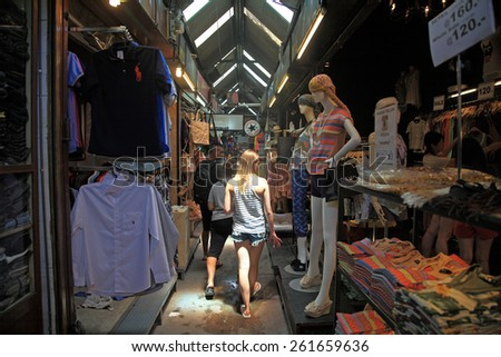 BANGKOK, THAILAND - JULY 05, 2014: Foreign Tourists at Chatuchak Weekend Market. Chatuchak is the largest outdoor street markets with 15,000 stalls in Thailand. - stock photo
