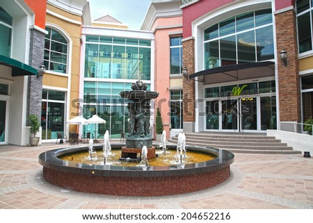 BANGKOK, THAILAND - JULY 11, 2014: Fountain and Vintage statue decorated at The Walk Kaset-Nawamin shopping mall, opened since August, 2013. - stock photo