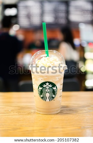 Bangkok ,Thailand-July 15 : Glass of Starbuck Coffee Frappuccino Blended Beverages served at wood table in starbuck shop at Seacon Department store, Bangkok, Thailand. - stock photo