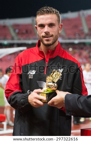 BANGKOK THAILAND JULY 14:Jordan Henderson of Liverpool show the gold shoes trophy the international friendly match Thai All Stars and Liverpool FC at Rajamangala Stadium on July14,2015 in,Thailand. - stock photo