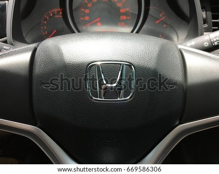 Bangkok, Thailand - July 1, 2017: Logo Honda on Black Steering Wheel. Honda is a Japanese multinational automotive manufacturing company.