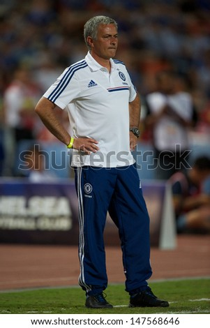 BANGKOK,THAILAND-JULY17:Manager Jose Mourinho of Chelsea look on during the international friendly match Chelsea FC and Singha Thailand All-Star at the Rajamangala Stadium on July17,2013 inThailand.