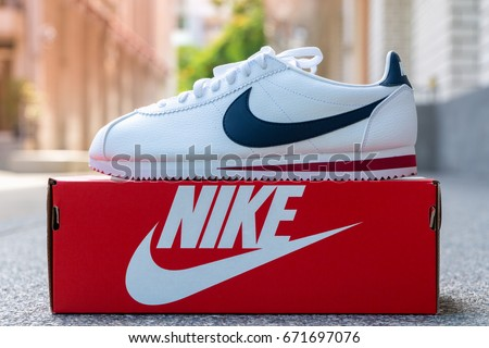 BANGKOK, THAILAND - JULY 2, 2017:Nike classic cortez white/midnight navy/gym-red   with box. Nike, Inc. is an American multinational corporation that designs, develops, manufactures and sells.