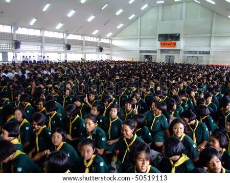 BANGKOK, THAILAND -  JULY 20 : School children sit at assembly at Suankularb school. July 20, 2006 in Bangkok. - stock photo