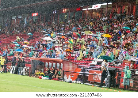 BANGKOK,THAILAND-JULY 13: The fan club of MTUTD between the game SCG Mungthong United and Songkhla United FC at SCG Mungthong Stadium on July 13, 2014 in,Thailand.