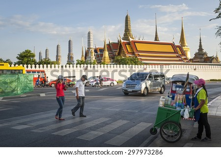 BANGKOK, THAILAND - July 11, 2015: Tourists visit the Grand Palace in Bangkok, Thailand on July 11, 2015. Grand Palace in Bangkok is the most famous temple and landmark of Thailand. - stock photo
