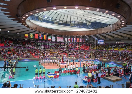 Bangkok, Thailand - July 3,2015 : Unidentified supporters on stand cheer and flag of the nation during  FIVB Volleyball World Prix Bangkok 2015 at Hua Mak Sport Complex.