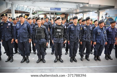 BANGKOK, THAILAND - JUN 1, 2014: Police officers stand to attention at a briefing while deployed to counter the threat of planned anti coup protests. Thailand has experienced its 19th coup since 1932.
