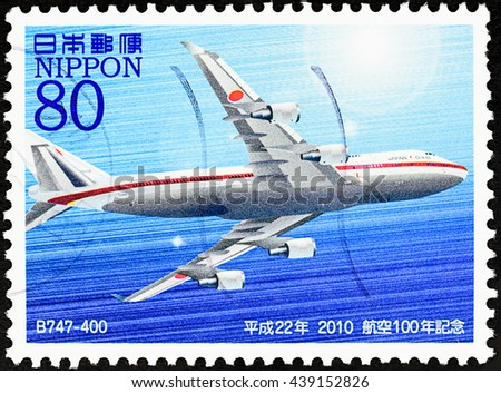 "BANGKOK, THAILAND - JUNE 18, 2016: A stamp printed in Japan shows boeing 747-400 airplane, series ""The 100th Anniversary of Aviation in Japan"", circa 2010. - stock photo"