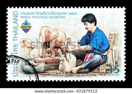 Bangkok Thailand - June 2010: A Thai postage stamp printed in Thailand depicting a traditional Thai handicrafts, circa 2003 - stock photo