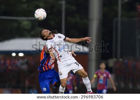 BANGKOK,THAILAND:JUNE 2015:Ali Diarra No15(Ivory Coast)and Dominic Adiyiah No.40(Ghana);PORT F.C.(O/B)vs Nakhon Ratchasima F.C.(W)at PAT Stadium;inThai Premier League on15July2015,Bangkok Thailand.  - stock photo